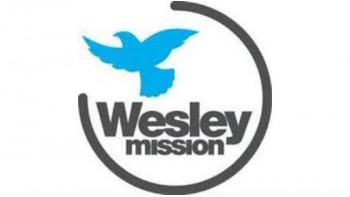Wesley Mission's logo